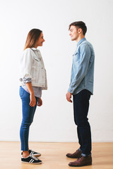 Side view of a couple wearing casual denim clothes.