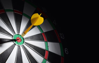 Dartboard with darts arrow hitting the center of the target. Marketing concept.