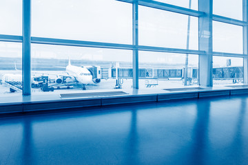 airport terminal and runway view,blue toned.