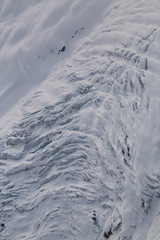Crevasse on top of a remote glacier mountain in British Columbia, Canada, viewed from airplane.