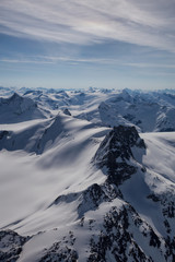 Aerial landscape view of the mountains. Taken far remote North West from Vancouver, British Columbia, Canada.