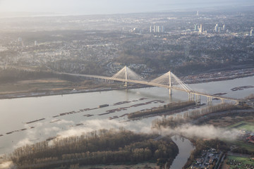 Aerial view on Fraser River and Port Mann Bridge. Taken early morning in Greater Vancouver, British Columbia, Canada.