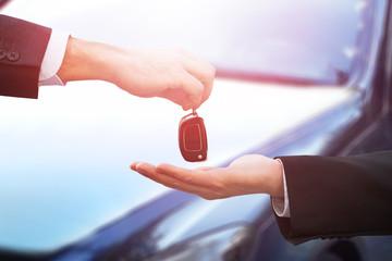 Car Dealer Giving Keys To Businessman
