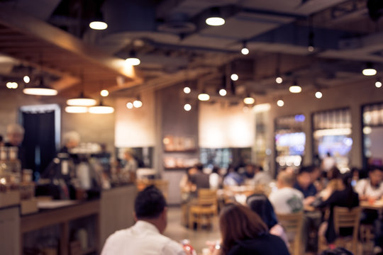 Blur coffee shop or cafe restaurant with abstract bokeh light.background idea