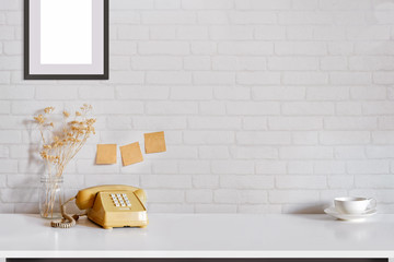 Contemporary desk Workplace with vintage telephone coffee cup and gadget wood table. Desk space Concept. Desk space background.