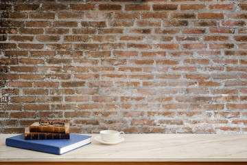Contemporary desk Workplace books stack with coffee cup Concept. Desk space background.