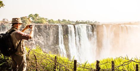 using a smart phone at Victoria Falls, Main Falls, Dry Season