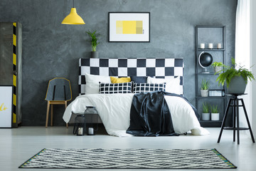 Bedroom with yellow poster