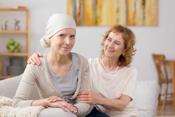 Cancer survivor sitting on couch