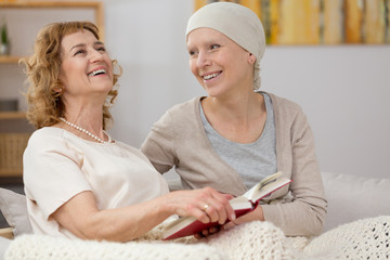 Woman reading book to patient