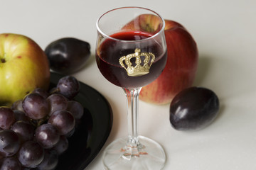 Wine and Grapes. Young Red Wine and grapes isolated on White Background. Focus On Foreground.