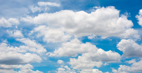 Many white clouds on blue sky