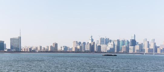 cityscape of modern city near river