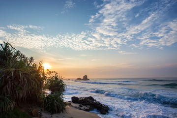 Tropical sunset and scenic beach