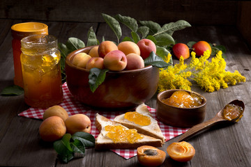 Still life apricots jelly glass jar bowl yellow flowers wooden table spoon Butterbrot wipes