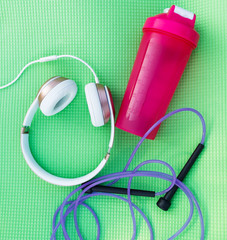 Picture of headphones, pink water bottle
