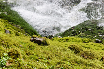 Dreamy waterfall and small emerald pond. Karst water. Fontanon of Goriuda. Friuli