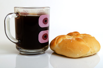 Coffee and bun on a light background.