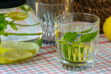 Classic lemonade with fresh mint on the table