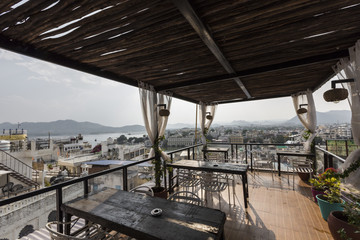 Roof top restaurant with beautiful view to Lake Pichola in the morning in Udaipur, Rajasthan, India