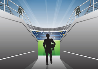 Football Player with a walking on a stadium tunnel