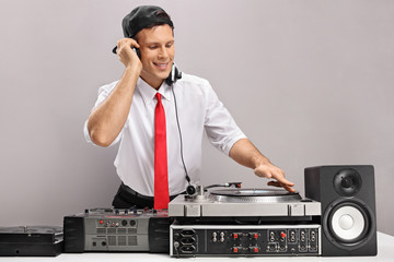 Formally dressed guy playing music on a turntable