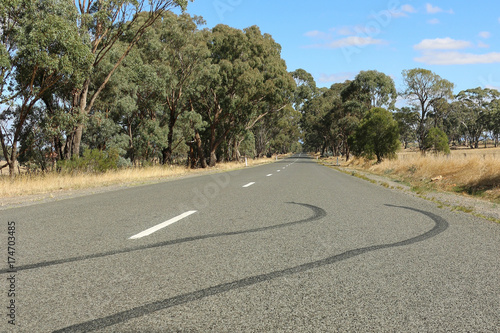 tyre skid marks on a country road stock photo and royalty free