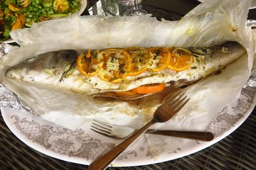 whole sea bass stuffed with orange, lavender and fennel served with zucchini courgette, broad bean, pea and mint salad