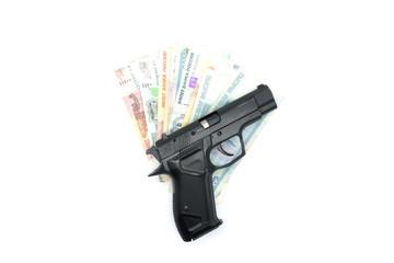 The black gun lies on the money