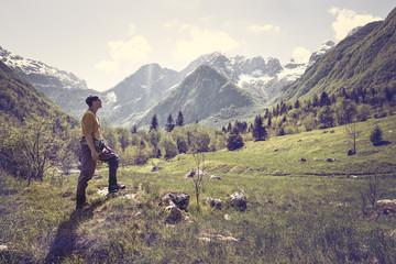 Slovenia, Bovec, man standing on meadow near Soca river