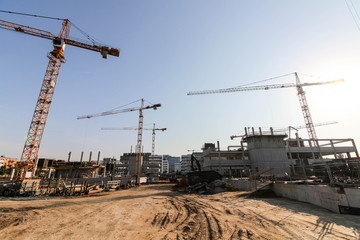 A large construction site with tower cranes