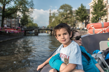 Mom and son boat through Amsterdam