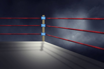 View of a regular boxing ring surrounded by red ropes spotlit by a spotlight