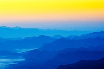 Beautiful silhouette mountains sunrise at Doi Inthanon National Park. Chiang Mai, Thailand.