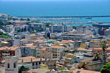 panoramic view of Cagliari seen from the Castle district with roof building, the sea, the marina and the harbor.
