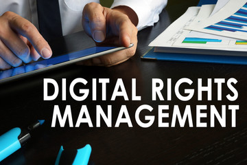 Digital rights management concept. Man is using tablet.