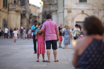 A crowd of tourists on the square at the Main Cathedral in Lecce, Italy.
