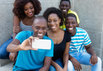 Group of five african american men and woman taking selfie