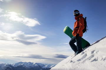 Small snowboarder on blue sky backdrop. Wall mural