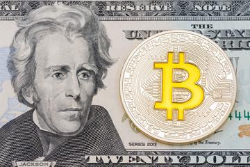Golden cruptocurrency yellow 'bitcoin on twenty dollar banknote background.