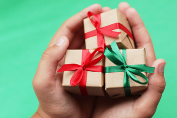 three little cute gift in hands