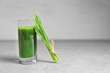Wheat grass shot on grey table