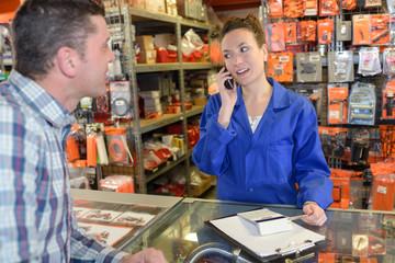 happy salesman assisting customer