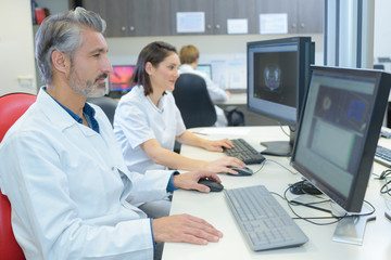 doctors working with laptop computer