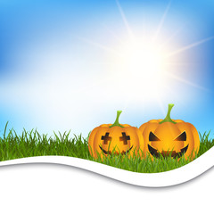 Fototapete - Halloween pumpkins in grass