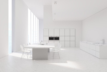 White kitchen with a table, ovens