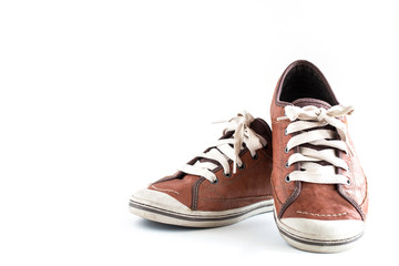 Old dirty sneaker on white background.Male Brown Leather Shoe.