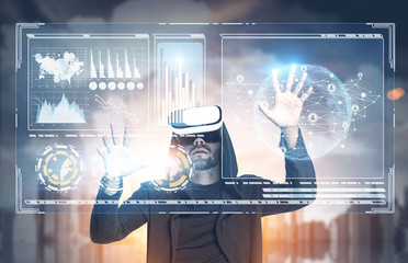 Man in VR glasses, HUD, infographics, city