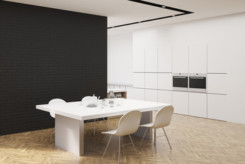 White and black kitchen with a table, corner