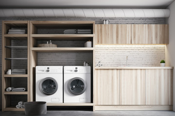 White and wooden laundry room interior close up